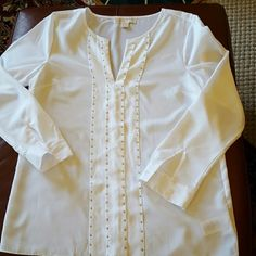 Michael Kors Sheer Blouse Crisp white sheer blouse with folded placket and gold studs. Very neck, peasant style with delicate cuffs and a straight bottom. Good used condition, tiny spot at hem (pic 4). I think this will come out. Nice price. MICHAEL Michael Kors Tops Blouses