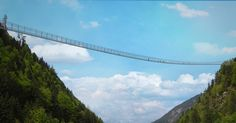 """Highline 197 world's longest suspension bridge connecting Ehrenberg Castle ruins and Fort  Claudia in Reutte. <---We couldn't resist doing the Monte Python, """"bridge of death"""" scene before walking across."""