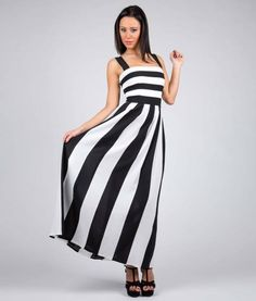 #italianStyle #madeinitaly Long dress decoltè in cadis with black and white stripes. Tight bodice. It closes with a zip on the back. Suitable for evening wear, for many cerimonies and party.