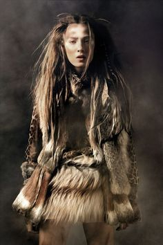 Wild warrior - fur clothing - tribal make up - Wild hairdressing