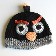 Ravelry: Child's Black Angry Birds Hat pattern by Elise engh Free pattern at http://growcreative.blogspot.ca/2013/11/free-crochet-pattern-black-angry-birds.html