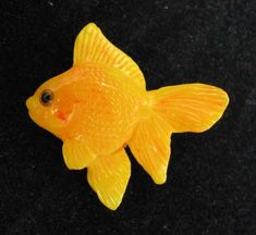 Contemporary goldfish button crafted from vintage Bakelite by super-talented artist Brad Elfrink.