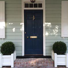 I've found THE color for our front door:  Gentleman's Gray by @benjamin_moore. Perfectly Southern Front Door Colors   @gardenandgun
