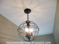 Orb Chandelier using two hanging garden baskets : $ 10, paint white or hammered silver