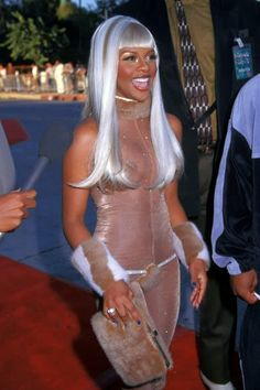 It's been so hard to find images of Lil Kim in this outfit. One of my favorite ones she wore. 1993
