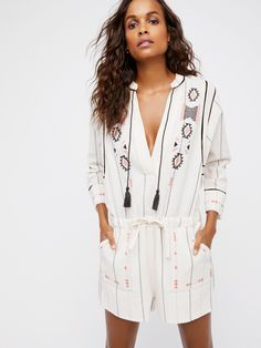 Baja Romper | Easy cotton romper with a comfortable, relaxed fit and tribal-inspired embroidery throughout.      * V-neckline with tasseled tie details    * Drawstring waist    * Side pockets    * Vented sleeve cuffs