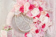Introducing the Marie Antoinette Lovely Marie Tea Time wreath collection with the Lovely Marie Roses and Romance wreath! If you love fabulous vintage laces, pretty in pink roses, satin ribbons, dripping bling jewels and florals you will absolutely adore this creation!! This is a millionaire stunning wreath with the perfect realistic roses and overflowing with the perfect vintage bridal laces, pearls and loads of romance!!! If you love romantic laces, roses, ribbons and florals together this…