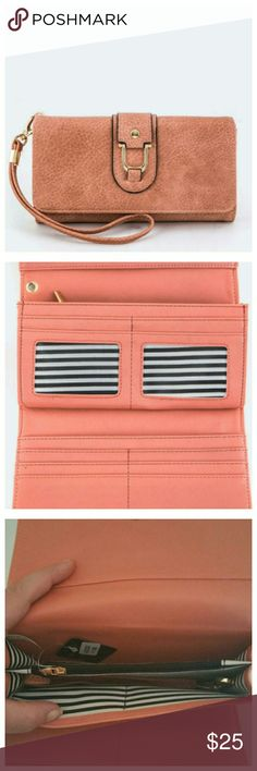"Pink Grain Leather Tri Fold Wallet Hand strap included. Measurements: Length 7.5"" Width: 1.5"" Height: 4"". Bags Wallets"
