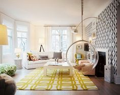Home decor.  A big, bold yellow colored rug sits in a an otherwise neutral room.  Love the geometric Black and White wall! #yellow #rug #pattern #interior design