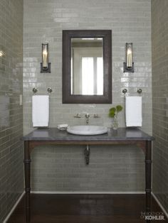 Moss green with Carrara marble vessel sink with a polished chrome, wall-mount faucet. (Kohler Botticelli khlr.co/lD1w)