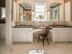 beautiful bathroom with double sink white vanity with window
