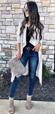 #winter #outfits women's black tops and white cardigan with blue denim jeans. Click To Shop This Look.