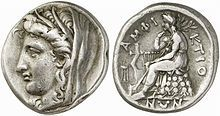 Silver stater from Delphi, 338/6-334/3 BC. Obv. Head of Demeter left, wearing grain-ear wreath and veil. Rev. Apollo seated left on omphalos, tripod to left, AMΦIKTIONΩN around.