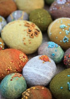 These almost look like they've spent a bit of time settled on the ocean floor. I think coral, barnacles, sea life and ocean colours would be gorgeous... Felted pebbles, stones, rocks