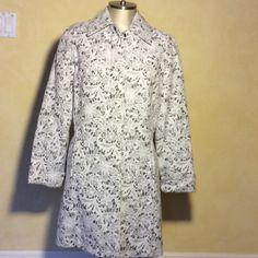 Mycrapac printed floral raincoat Barely worn, stylish and sophisticated mycrapac raincoat Mycrapac Jackets & Coats