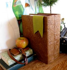 DIY Faux Leather Book Covers by Brenna via designsponge: Simply made with upcycled brown paper bags, and iron and shellac. #Book_Covers #Brenna #DIY