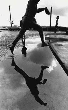 Puddle jumping in Seattle | Pete Liddell Seattle Times photographer from 1966-1992 | The Seattle Times