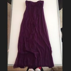 """Amsale 100% Silk Dress Amsale 100% silk strapless bridesmaids/prom dress. Size 8 long. Beautiful eggplant color. Worn once as a bridesmaid. The true color of the dress is closest displayed in the first 3 pics. There is a snag and a mark on the from bottom of the dress. Please see the last photo. They are hard to see because of the textured silk. And because this dress is so long most people will probably have to shorten it and the snag would be cut off. Dress is about 52"""" long from the top…"""