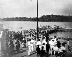 Band members and others on dock, Lake Como, St. Paul, 1906. Format: photprint