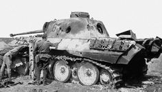 Russian soldiers inspecting the burnt out remains of Panther Ausf D no. 634