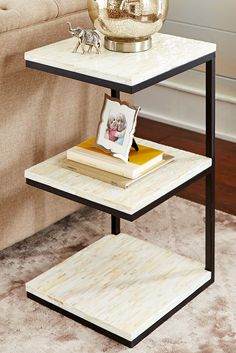 Elegant and modern, Pier 1's hand-laid mother-of-pearl tiered table is a great accent piece that triples your storage space. Three shelves for convenient stacking options—magazines, remotes, etc. And its sparkling mosaic tile design brings a grand quality to any small space.