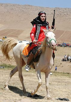 Bakhtiari fighter//The Bakhtiari (Persian: بختیاری‎‎) are a southwestern Iranian tribe, and a subgroup of the Lurs. They speak the Bakhtiari dialect, a southwestern Iranian dialect, belonging to the Lurish language. Iranian Women, Persian Culture, Female Soldier, Military Women, Kurdistan, Women In History, World Cultures, People Around The World, Georgia