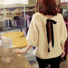 THIS EXACT SWEATER WITH THE OPEN BOW BACK