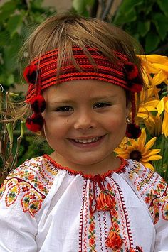 Adorable girl from The Ukraine, Twist- Both are dressed in beautiful decorative clothing w shades of red