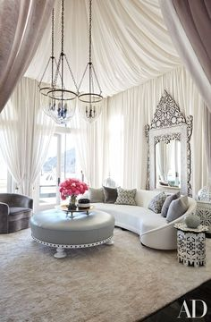 4. Infuse whimsy.  Bullard draped sheer fabric of his own design to create volume and dimension in Khloé's ornate living room, which evokes a sumptuous take on a Bedouin tent, complete with carved-wood accent tables and and a Levantine mirror.