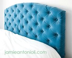 Build yourself a tufted turquoise headboard to draw attention to what matters most in your room (the bed, duh).