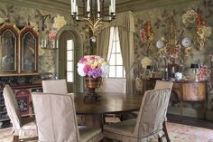 The striking overscale pattern of this DeGournay wallpaper is hand painted on silk.