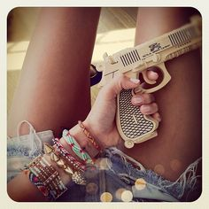 Girls have guns too- love the indie look with the bracelets and cut off shorts- def my style