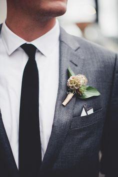 Scabiosa pod and succulent groom boutonniere