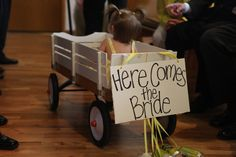Our flower girl was just learning how to walk, so we opted for the wagon ride.  My groom walked down, wheeling her in.  photog: www.christinrose.com