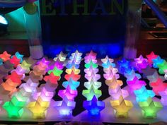 Glowing neon stars serve as place cards for a space theme Bar Mitzvah! By PARTIES! Rare To Well Done Bar Mitzvah Decorations, Bat Mitzvah Centerpieces, Star Centerpieces, Bat Mitzvah Themes, Bar Mitzvah Party, Star Decorations, Neon Party Themes, Carnival Themed Party, Fireworks Design
