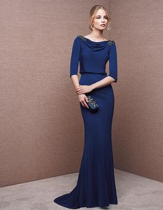 Dress with bateau neckline, encrusted with gemstone embroidery