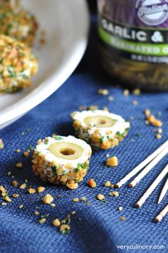 Marinated olives are coated in an herbed-cheese mixture, then rolled in toasted nuts for an easy and super tasty appetizer!