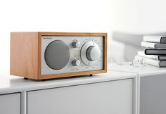 Give dad the gift of great sound.  Behind the simple design of the Model One® is award-winning technology that produces a rich, full sound. Designed by Henry Kloss, the analog dial allows for precise tuning, while the auxiliary input makes it compatible with iPods and MP3 players.  Uncover more at Room and Board http://www.roomandboard.com