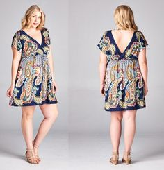 The perfect spring/summer dress! Beautiful paisley print in shades of navy blue, white, and orange. Empire waist is elastic and is so stretchy and comfortable. V-neck in the front and in the back is s