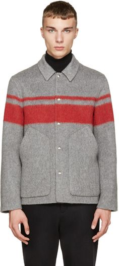 Long sleeve brushed mohair jacket in grey. Spread collar. Press-stud collar. Scoop pocket at front. Accent stripes at body and sleeves in red. Tonal stitching.