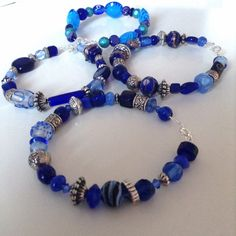 Handmade bracelets (blue and silver), materials from John Lewis and Jewellery Shed. Some beads have also been taken off necklaces/bracelets from charity shops - great because these are cheaper and it means you are recycling old jewellery!
