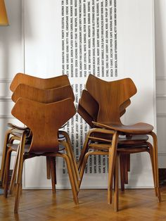 A stack of 1955 Grand Prix chairs by Arne Jacobsen rests besides a minimal art piece