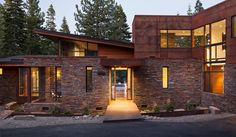 stone, metal cladding aligned with windows for seams, wood siding and comp. roof Martis Camp 97 | Projects | Ward-Young Architecture