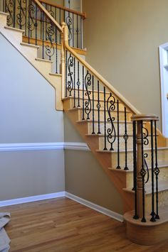 wood and rod iron staircase | ... - Upgrade your staircase! Replace wood balusters with wrought Iron
