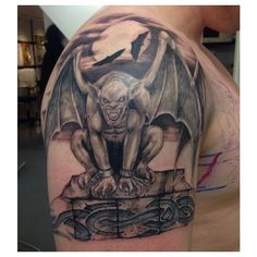 Looking to add something like this to my chest piece. Except more detail, and a more intense face on the gargoyle. He's gotta be intimidating. The idea behind it is he will be guarding my son being that he will go underneath my sons name.