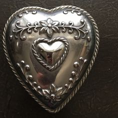"""Brighton silver heart trinket holder Brighton silver heart trinket holder. Beautiful detail on front and back makes this a nice accessory piece on a dresser, nightstand or bathroom vanity. At longest point it is 4.5"""" and at widest point it is 4"""". Brighton Accessories"""