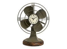 Part industrial chic, part mad-scientist art, this Thatcher Vintage Fan Clock combines two iconic pieces into one fabulous decorative item. Though the fan doesn't work, the quartz clock does, giving you a sense of time and style that few will be able to match.
