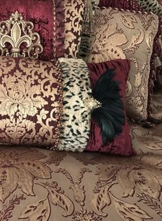 Majesty Luxury Bedding by Reilly-Chance Collection combines rich burgundy and gold tones for a look that is fit for a Queen! The jacquard patterns, along with the soft, crushed velvet and faux leopard fur create a luxurious look and feel. The pillows are adorned with beads, feathers,tassel fringe and Swarovski Crystal covered embellishments.