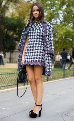 Striking a pose in a Chanel houndstooth jacket and shift dress.  Miroslava Duma