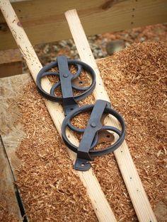 Two Black Cast Iron Wheels
